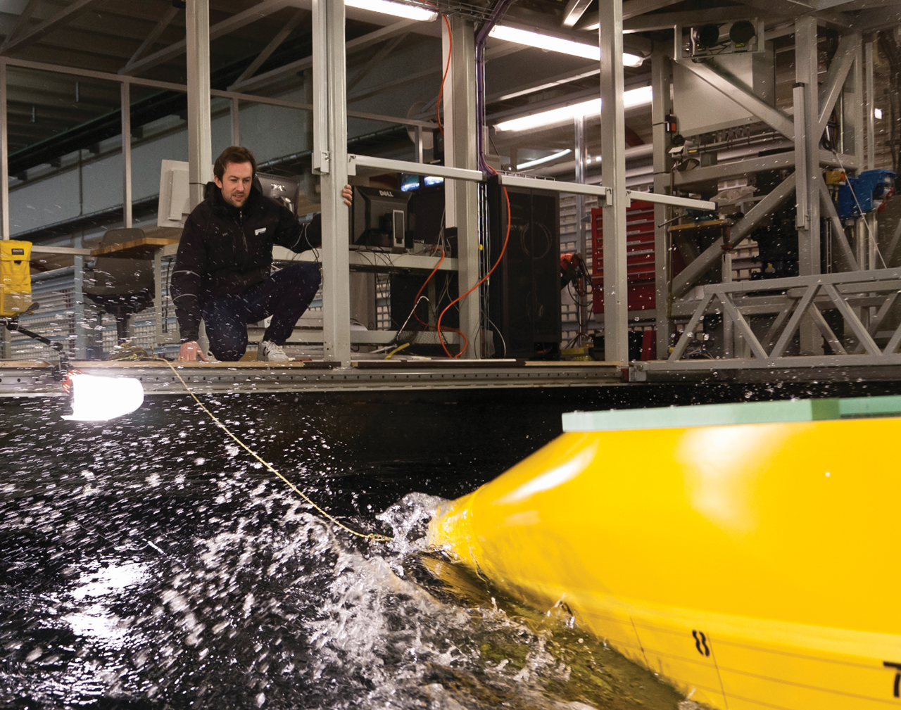Toralf Hamstad tests a new hull in the ship model tank at SINTEF in Trondheim, Norway. Photo: Thor Nielsen.